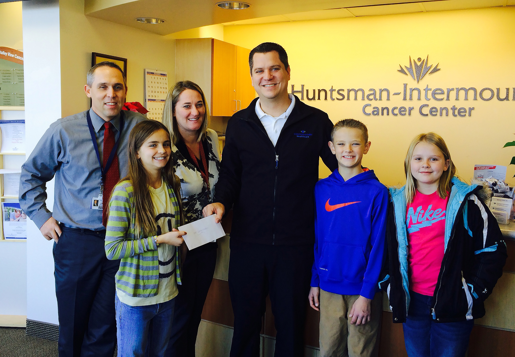 Students and teachers pose at the Cancer Center as they deliver the check to help patients and families, Valley View Medical Center, Cedar City, Utah, Dec. 2, 2014 | Photo courtesy of Valley View Medical Center, St. George News