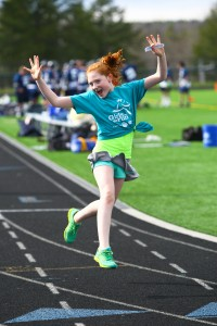 A girl celebrates while running her 5k at the end of her partcipation in the program, location and date unspecified | Photo courtesy of Girls on the Run, St. George  News
