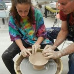 Tonaquint Intermediate student Taisley Welch throws a pot in preparation for last year's Soup-N-Bowl event, with ceramist Joe Viers providing direction, St. George, Utah, date not specified | Photo courtesy of Linda Sappington, St. George News