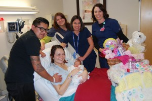The parents and newborn baby pose with staff at Valley View Medical Center after the family was given  gift baskets, Valley View Medical Center, Cedar City Utah, Jan. 1, 2015 | Photo courtesy of Valley View Medical Center, St. George News