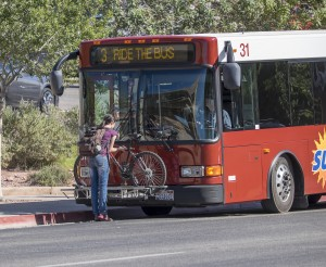 A SunTran rider puts their bike on the front of a bus, St. George, Utah, undated | Image courtesy of Dixie Regional Travel Expo, St. George News
