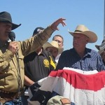 Ryan Bundy, holding microphone, recaps events related to the BLM-Bundy Ranch standoff over impounded cattle, Bunkerville, Nevada, April 2014 | Photo by Mori Kessler, St. George News