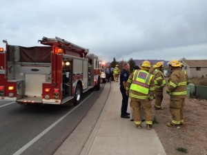 Emergency responders gather after a  car crashed into a shed on South Dixie Drive, St. George, Utah, Jan. 20, 2015 | Photo courtesy of Melissa Anderson, St. George News