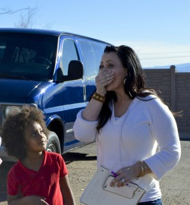 L-R: Maliyah McBride, Tiffany McDonald. Foster parent Tiffany McDonald's first reaction to the surprise donation of a van to help her family. Switchpoint Community Resource Center, St. George, Utah, Jan. 23, 2015 | Photo by Candice McMahon, St. George News