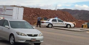 An officer stand by his patrol car blocking an entrance into the Goldenwest Credit Union parking lot. He and other officers are responding to a potential incident inside the credit union that turned out to be a false alarm, St. George, Utah, Jan. 30, 2015 | Reader-submitted photo, St. George News