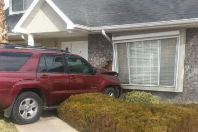 The aftermath after the vehicle crashed into a residence at 2056 W. Canyon View Drive in St. George, Utah, Jan. 23, 2015 | Photo courtesy of St. George Police Sgt. Sam Despain, St. George News