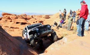 Bryce Thompson spotting Richard Mick during the Winter 4x4 Jamboree 2015, one of several off-road events held in the Sand Mountain OHV, Hurricane, Utah, Jan. 24, 2015 | Photo by Leanna Bergeron, St. George News