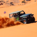 "A Jeep Wrangler kicking up some dust on ""The Slide"", Jan. 24, 2015, Sand Hollow State Park 