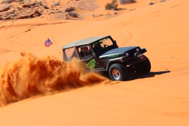 """A Jeep Wrangler kicking up some dust on """"The Slide"""", Jan. 24, 2015, Sand Hollow State Park   Photo by Leanna Bergeron, St. George News"""