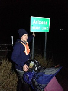 Joshua Bryant at the Arizona-Utah state line, where he prepares to run to Idaho in eight days, near St. George, Utah, Jan. 21, 2015 | Photo courtesy of Joshua Bryant, St. George News