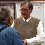 Phil Peterson, St. George's retiring finance director, speaking to a friend who is wishing him well in retirement, St. George, Utah, Jan. 29, 2015 | Photo by Mori Kessler, St. George News