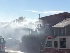 Fire crews battle a house fire in Hurricane, Utah, Feb. 25, 2015 | Photo by Kimberly Scott, St. George News