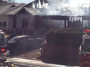 Fire crews battle house fire in Hurricane, Utah, Feb. 25, 2015 | Photo by Kimberly Scott, St. George News
