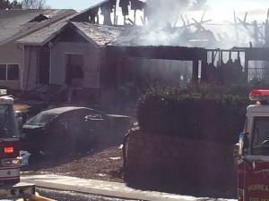 Fire crews battle house fire in Hurricane, Utah, Feb. 25, 2015 | Photo by Kimberly Scott, St. George News
