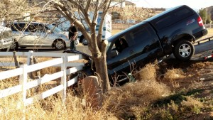 The damaged Ford pickup truck stuck in the ditch by 2800 South and River Road, St. George, Utah, Feb. 12, 2015 | Photo by Mori Kessler, St. George News