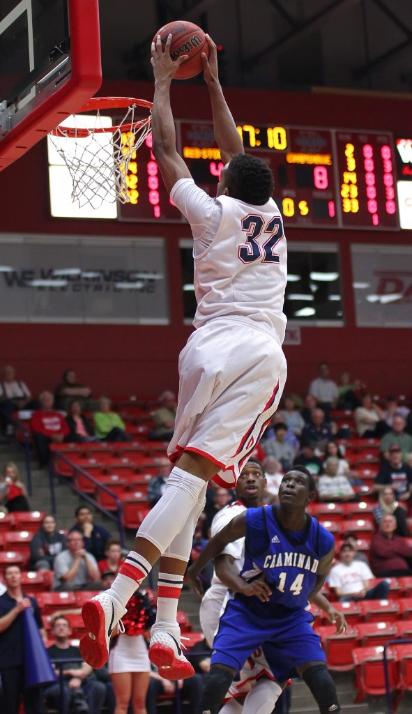 Mark Ogden (32) finishes an alley-oop from DeQuan Thompson for the Red Storm, Dixie State University vs. Chaminade University, Mens Basketball, St. George, Utah, Feb. 12, 2015 | Photo by Robert Hoppie, ASPpix.com, St. George News