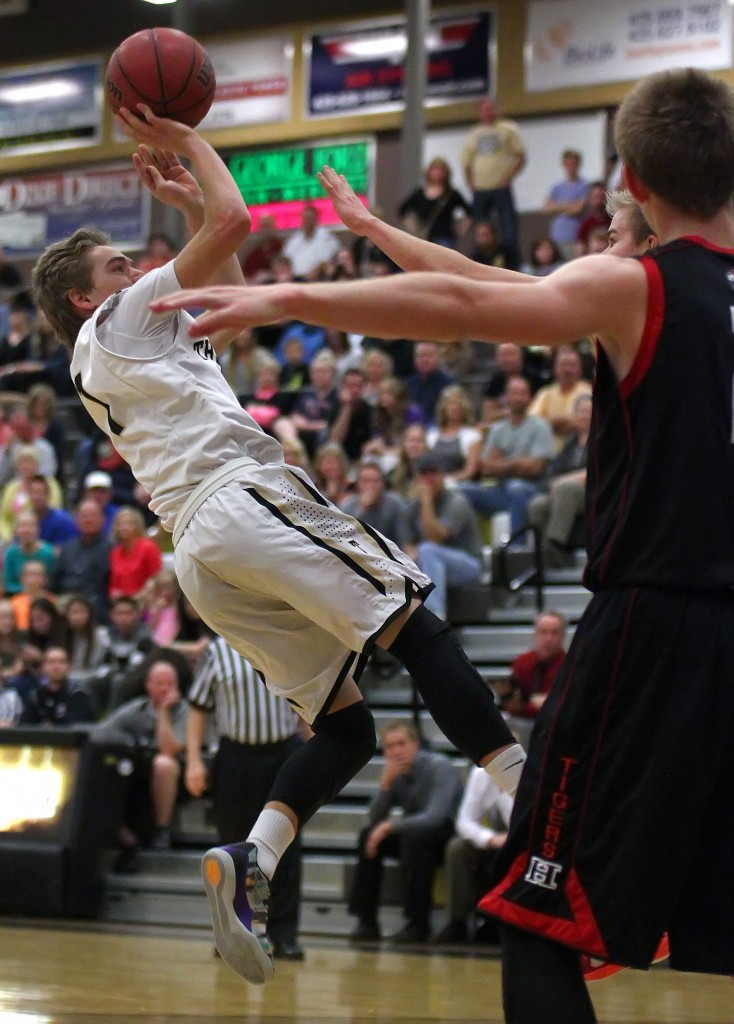 Logan Hokanson takes an off-balance shot for the Thunder, Hurricane vs. Desert Hills, Boys Basketball, St. George, Utah, Feb. 13, 2015 | Photo by Robert Hoppie, ASPpix.com, St. George News