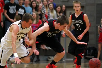 Thunder G Max Mills and Tiger F Austen Beatty chase down a loose ball, Hurricane vs. Desert Hills, Boys Basketball, St. George, Utah, Feb. 13, 2015 | Photo by Robert Hoppie, ASPpix.com, St. George News