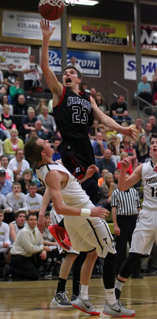 Kaden Langston (23) flies to the hoop over Max Mills, Langston would be called for a charge on this play, Hurricane vs. Desert Hills, Boys Basketball, St. George, Utah, Feb. 13, 2015 | Photo by Robert Hoppie, ASPpix.com, St. George News