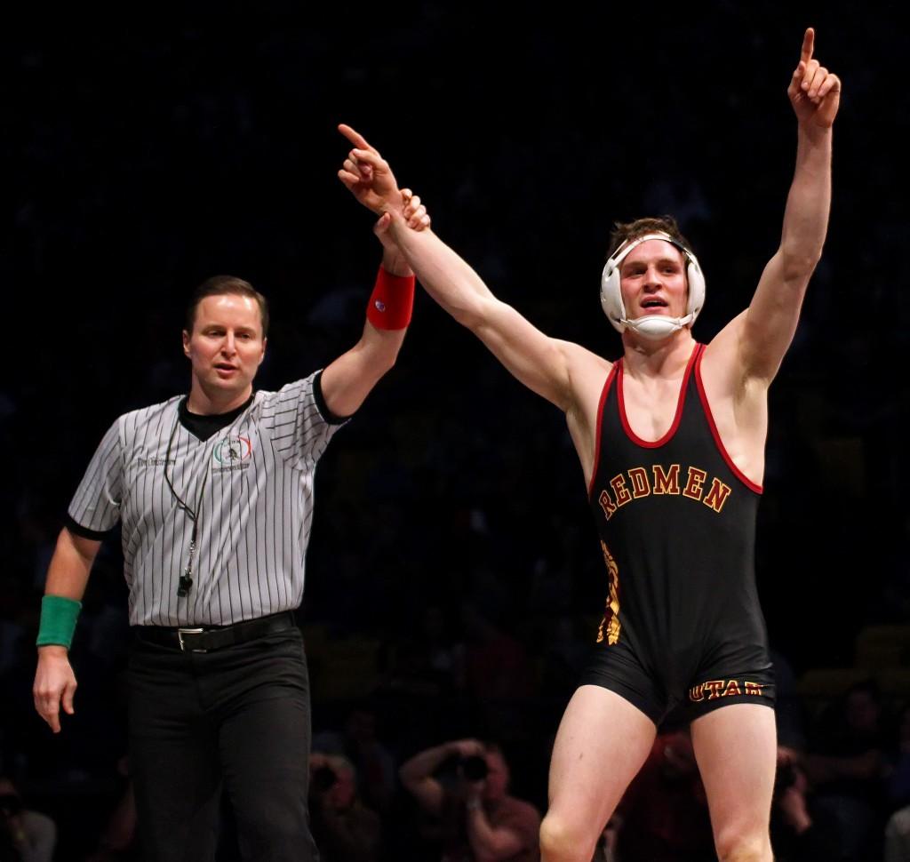 Dallin Brooks (black singlet) wins the 160-pound state final match for Cedar, 3A State Wrestling Tournament, Orem, Utah, Feb. 14, 2015 | Photo by Robert Hoppie, ASPpix.com, St. George News