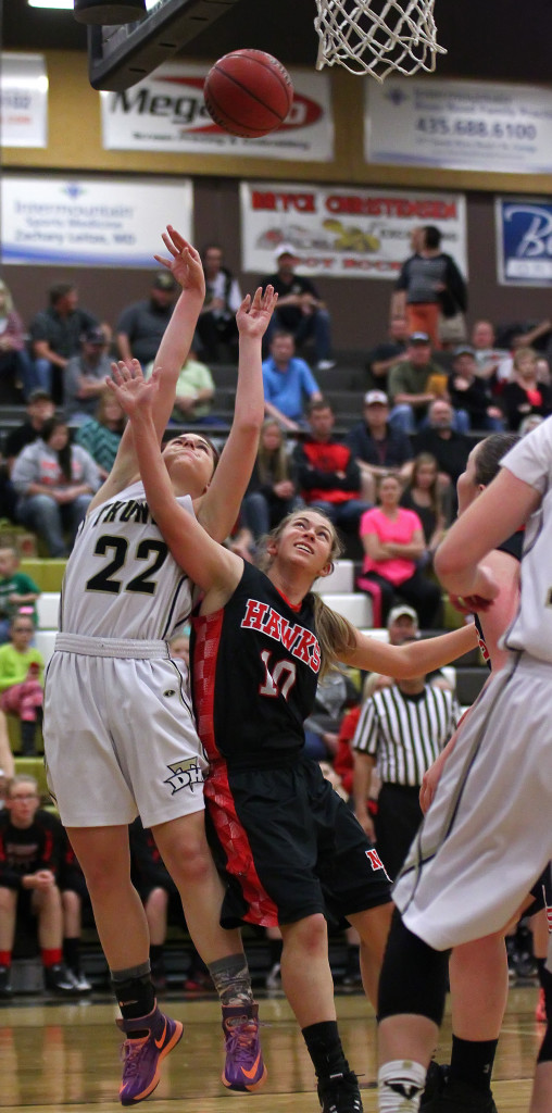 Kendyl Larson (22) is fouled on a shot in the paint, North Sanpete vs. Desert Hills, Girls Basketball, St. George,  Utah, Feb. 21, 2015 | Photo by Rober Hoppie, ASPpix.com, St. George News