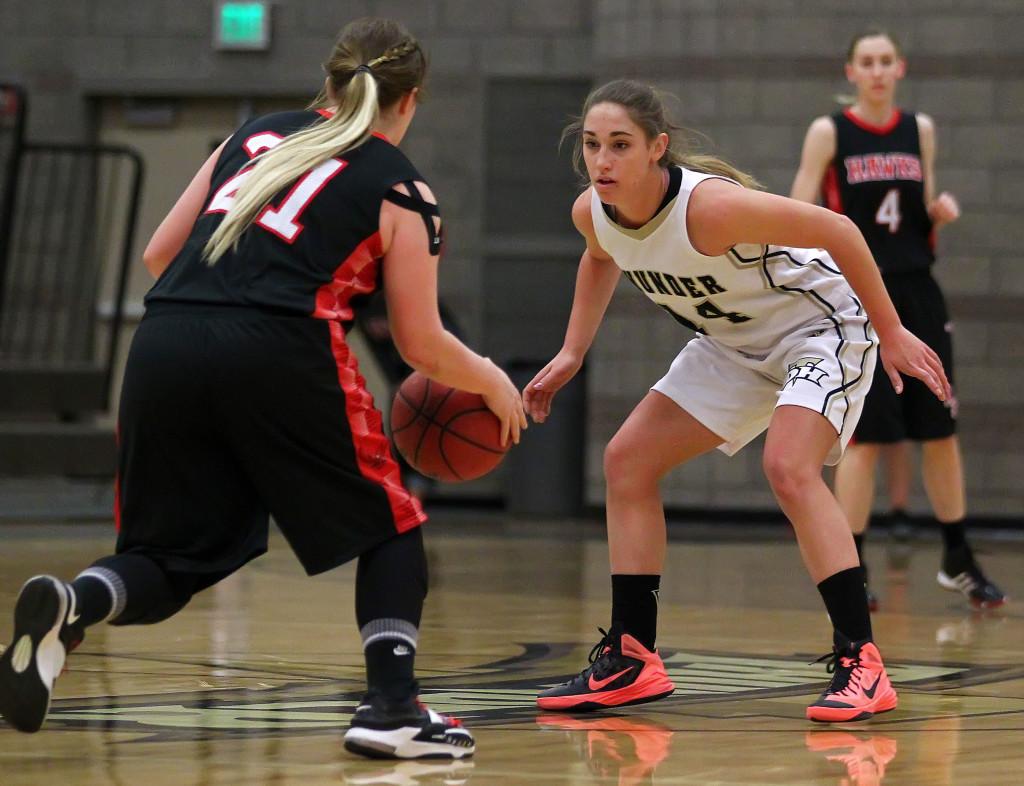 Kenzie Done faces up North Sanpete's Aubrey Madsen, North Sanpete vs. Desert Hills, Girls Basketball, St. George,  Utah, Feb. 21, 2015 | Photo by Rober Hoppie, ASPpix.com, St. George News