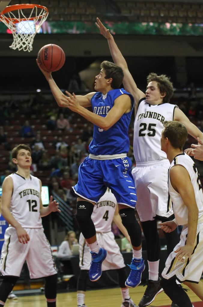 Tyler Bennett slips a shot past Austin Adams (25), Desert Hills vs. Dixie, 3A State Basketball Tournament, Salt Lake City, Utah, Feb. 27, 2015 | Photo by Robert Hoppie, ASPpix.com, St. George News