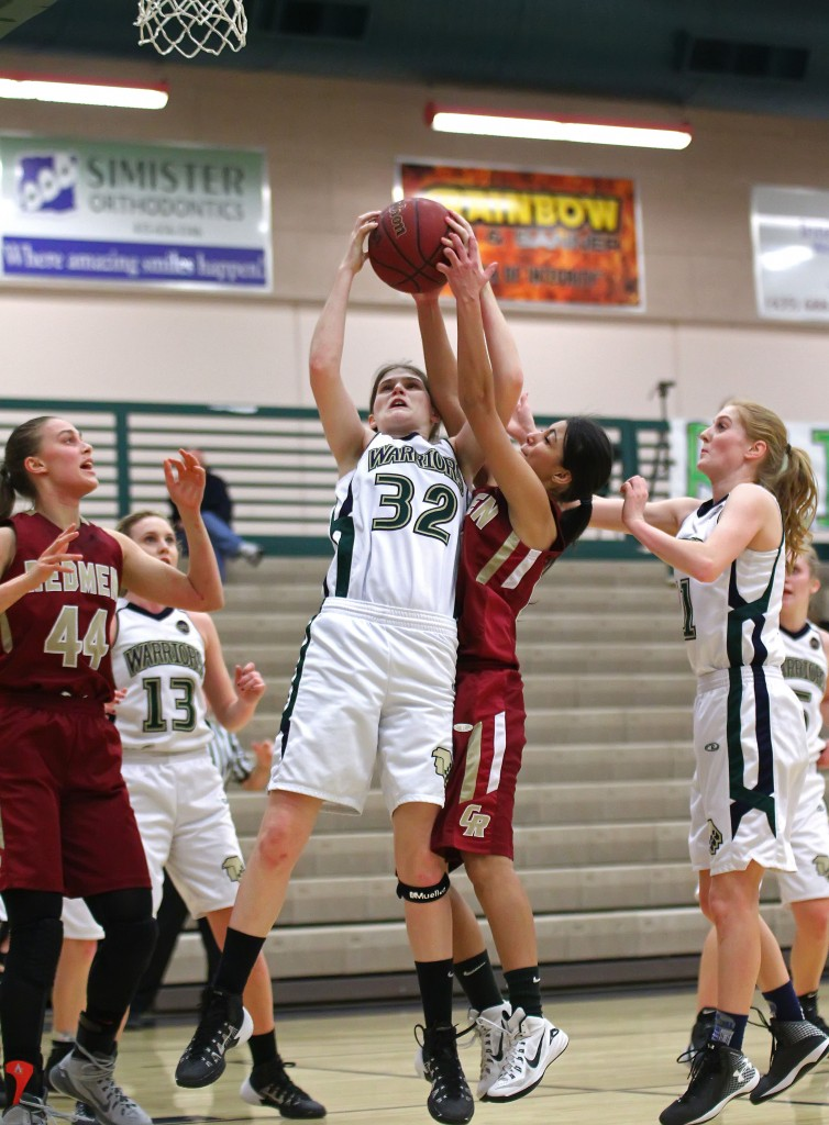 Snow Canyon's Lindsy McConnell (32) grabs a rebound, Cedar vs. Snow Canyon, Girls Basketball, St. George, Utah, Feb. 3, 2015 | Photo by Robert Hoppie, ASPpix.com, St. George News