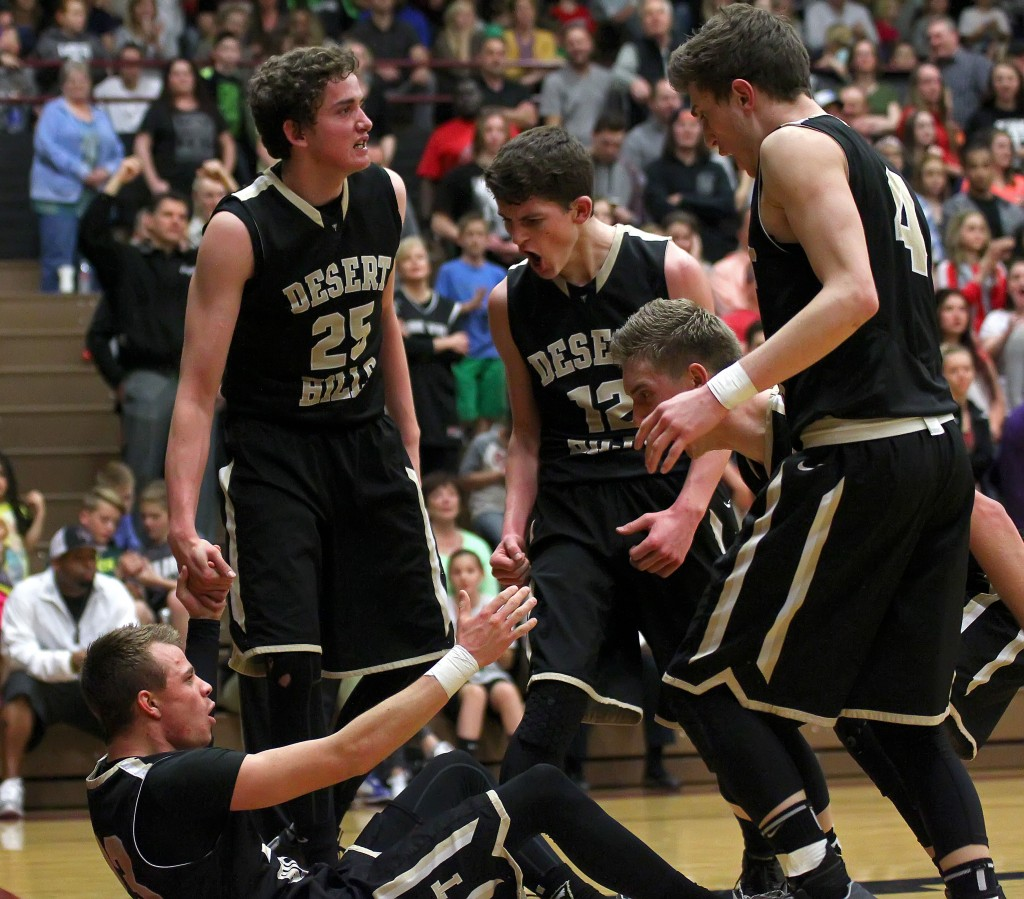 Max Mills gets help from his Thunder teammates after taking a charge, Desert Hills vs. Pine View, Boys Basketball, St. George, Utah, Feb. 4, 2015 | Photo by Robert Hoppie, ASPpix.com, St. George News