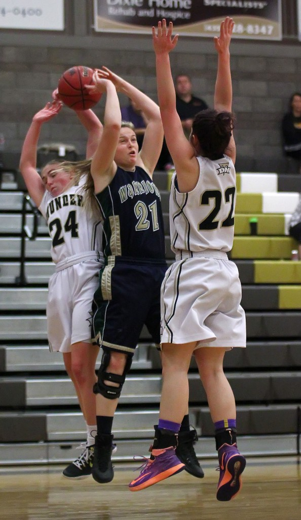 Thunder G Ashley Beckstrand (24) grabs the ball from Warrior G Madison Mooring (21), Snow Canyon vs. Desert Hills, Girls Basketball, St. George, Utah, Feb. 5, 2015 | Photo by Robert Hoppie, ASPpix.com, St. George News