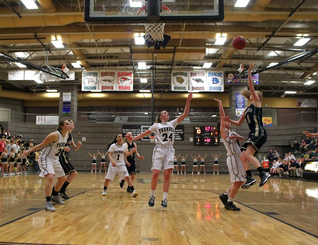 Nikenna Durante drives the lane and puts up a layup for Snow Canyon, Snow Canyon vs. Desert Hills, Girls Basketball, St. George, Utah, Feb. 5, 2015 | Photo by Robert Hoppie, ASPpix.com, St. George News