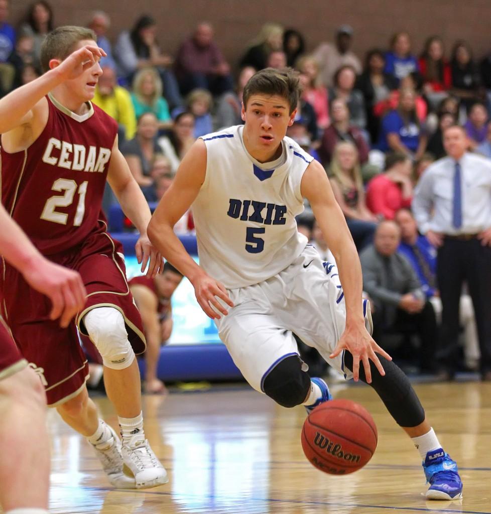 Dixie G Tyler Bennett (5) drives against Keenan Neilson (21), Dixie vs. Cedar, Boys Basketball, St. George, Utah, Feb. 6, 2015   Photo by Robert Hoppie, ASPpix.com, St. George News