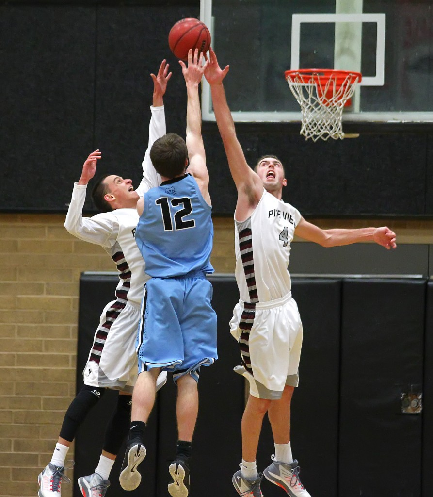 Jed Newby and Kody Wilstead (4) contest a jumper by Falcon F Derek Dunnell (12), Pine View vs. Canyon View, Boys Basketball, St. George, Utah, Feb. 6, 2015 | Photo by Robert Hoppie, ASPpix.com, St. George News