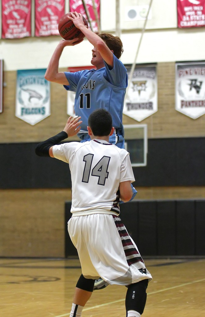 Sterling Barnes (11) fires up a 3-pointer at the end of regulation time to tie the game, Pine View vs. Canyon View, Boys Basketball, St. George, Utah, Feb. 6, 2015 | Photo by Robert Hoppie, ASPpix.com, St. George News