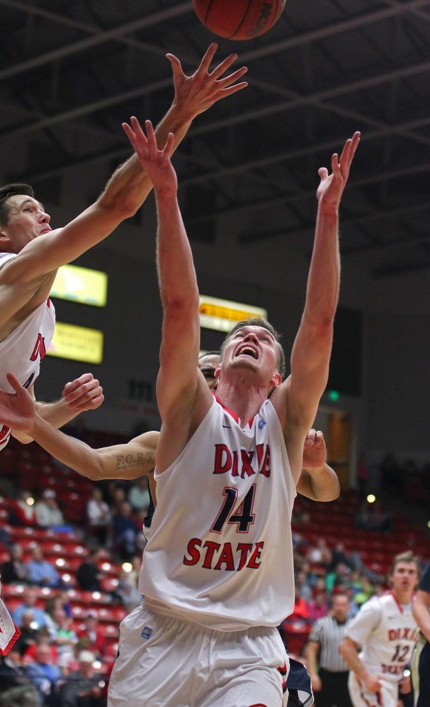Zach Robbins and Robbie Nielson (14) reach for a rebound, Dixie State University vs. Notre Dame De Namur, Mens Basketball, St. George, Utah, Feb. 7, 2015 | Photo by Robert Hoppie, ASPpix.com, St. George News