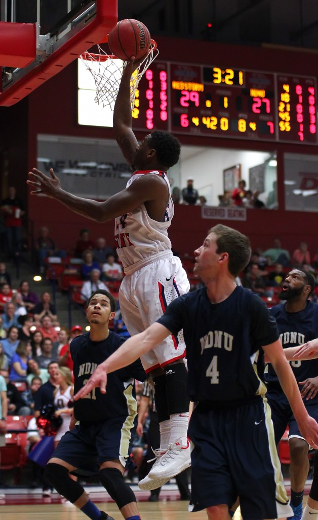 DeQuan Thompson drives to the hoop for the Red Storm, Dixie State University vs. Notre Dame De Namur, Mens Basketball, St. George, Utah, Feb. 7, 2015 | Photo by Robert Hoppie, ASPpix.com, St. George News