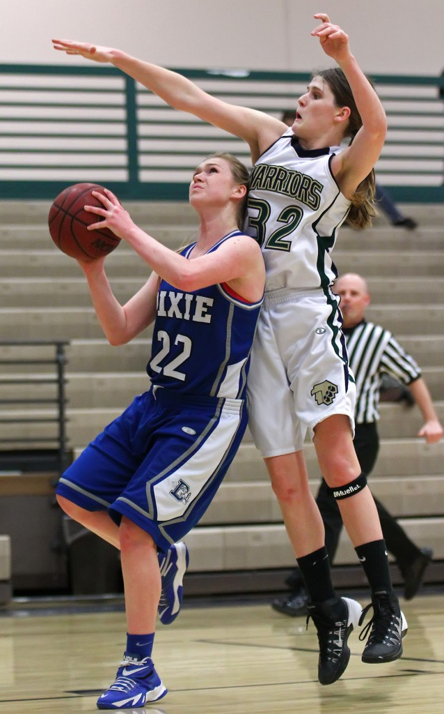 Alexa Estridge (22) is fouled by Lindsy McConnell (32) on a layup attempt, Dixie vs. Snow Canyon, Girls Basketball, St. George, Utah, Feb. 10, 2015 | Photo by Robert Hoppie, ASPpix.com, St. George News