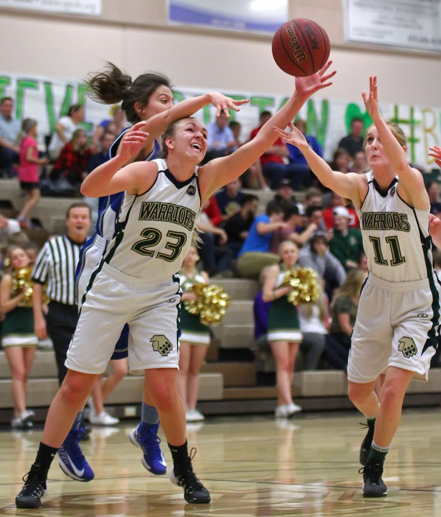 Lady Warriors Christee Wilson (23) and Nikenna Durante (11) reach for a loose ball, Dixie vs. Snow Canyon, Girls Basketball, St. George, Utah, Feb. 10, 2015 | Photo by Robert Hoppie, ASPpix.com, St. George News