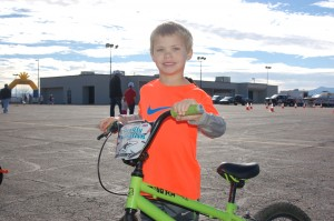 Trevin Kirk, 4, is all smiles after completing his race at the Move It! Kids criterium held at the Ridge Top Complex, St. George, Utah, Feb. 7, 2015 | Photo by Hollie Reina, St. George News