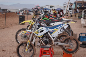 Dirtbikes parked on stands create a staging area for racers participating in the Midwest Area Loretta Lynn Qualifier at the SGMX Motoproving Ground, St. George, Utah, Feb. 21, 2015 | Photo by Hollie Reina, St. George News