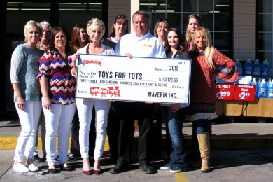 Maverik Inc Red Rock region store managers present Toys for Tots Beaver and Iron counties coordinator with donation, Cedar City, Utah, Feb. 18, 2015 | Photo by Carin Miller, St. George News