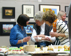 Friendly chatter around the dessert table, Artisans Art Gallery, Cedar City, Utah, Feb. 21, 2015 | Photo by Carin Miller, St. George News