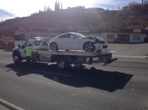 A white passenger car is towed from the scene of  an accident on North Bluff Street, St. George, Utah, Feb. 12, 2015 | Photo by Holly Coombs, St. George News