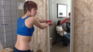 Ella Christilaw, 13, watches in the side mirror as she works through her physical therapy exercises to improve her scoliosis condition, St. George, Utah, Feb. 12, 2015  Photo by Holly Coombs, St. George News