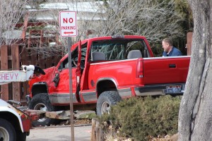 Officials asses how best to remove the truck involved in an accident in front of Cedar City High School, 550 W. 600 South, Cedar City, Utah, Feb. 3, 2015 | Photo by Devan Chavez, St. George News