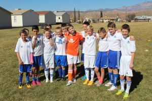 The Aggies FC youth soccer team from Logan poses for a team photo before their final game for the top spot in the Ice Breaker tournament, Washington City Community Center, Washington City, Utah, Feb. 16, 2015 | Photo by Devan Chavez, St. George News