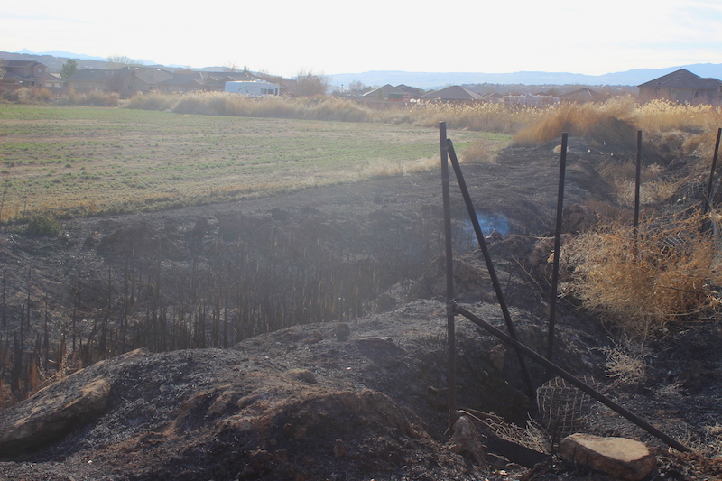The area of a previous agricultural burn continues to smolder hours after Washington City Fire Department asked the burner to cease due to the high wind, Washington City, Utah, Feb. 16, 2014 | Photo by Devan Chavez, St. George News