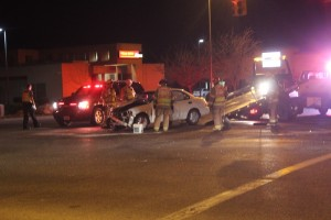 Emergency responders remove a vehicle from the scene following an accident at the intersection of Riverside Drive and River Road Monday night, Feb. 16, 2015 | Photo by Devan Chavez, St. George News