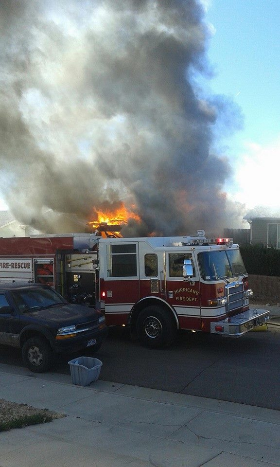 Fire crews battle house fire in Hurricane, Utah, Feb. 25, 2015 | Photo courtesy of Justin Mertlich, St. George News