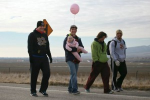"""Utah's Forrest Gump,"" Joshua Bryant walks with friends and family toward the finish line at the state line into Idaho, near Portage, Utah, Feb. 1, 2015 